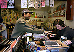 Alex Patterson, left, sells cds to Jason Costanzo,  owner of Sound on Sound record shop, in Austin, Texas on February 14, 2009. Austin hosts the South by Southwest Music Festival and is home to notable record stores that continue to stock, buy and sell vinyl records enriching its homegrown music scene.  (Photo by Ben Sklar for the New York Times)