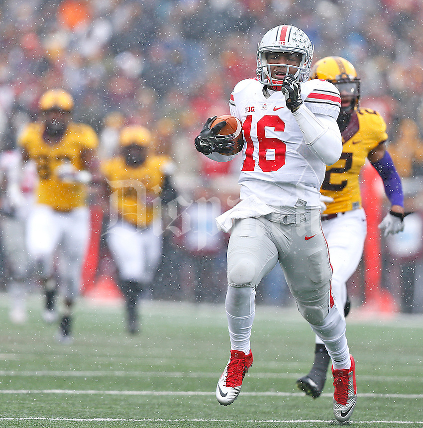 Ohio State Buckeyes quarterback J.T. Barrett (16) runs for a TD in the first quarter against the Gophers at TCF Bank Stadium on November 15, 2014. (Chris Russell/Dispatch Photo)