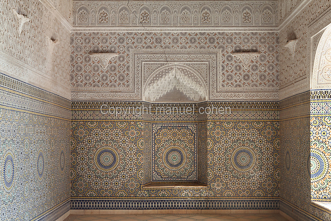 Reception room with carved stucco decoration and zellige tiles, Kasbah of the Glaoua family, Telouet, High Atlas, Morocco. Zellige tiles are terracotta tiles covered with 5 colours of enamel and set into plaster in decorative patterns. The fortress was begun in the 19th century as the residence Thami el Glaoui, 1879-1956, who was Pasha of Marrakech 1912-56. It sits at 1800m in the Atlas mountains on an ancient caravan route from the Sahara to Marrakech. Picture by Manuel Cohen