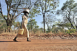 A woman carries water home in the Southern Sudan village of Kupera. The well where she obtained the water was installed by Catholic Relief Services (CRS). Families here returned from refuge in Uganda in 2006 following the 2005 Comprehensive Peace Agreement between the north and south. NOTE: In July 2011, Southern Sudan became the independent country of South Sudan