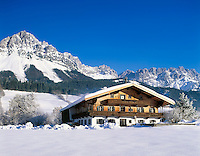 Austria, Tyrol, Kaiserwinkl, near Ellmau: Winter Scenery,  farmhouse and Wilder Kaiser Mountain