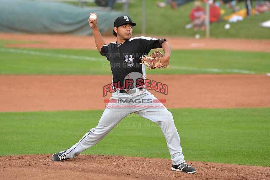 Javier Palacios (15) of the Grand Junction Rockies delivers a pitch to the plate against the Ogden Raptors during Opening Night of the Pioneer League Season on June 16, 2014 at Lindquist Field in Ogden, Utah. (Stephen Smith/Four Seam Images)