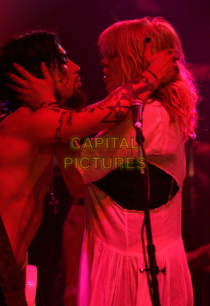DAVE NAVARRO & COURTNEY LOVE .Perform at The Camp Freddy South East Asia Tsunami Relief Fund Benefit held at The Key Club in West Hollywood, California .January 27th, 2005.half length, music, stage, gig, concert, holding heads, kissing, embrace, hug, gesture.www.capitalpictures.com.sales@capitalpictures.com.Supplied By Capital PIctures