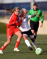 Allie Long of the Washington Freedom fights for the ball with Caroline Seger of the Philadelphia Independence during their preseason game at the Maryland SoccerPlex in Germantown, Maryland.