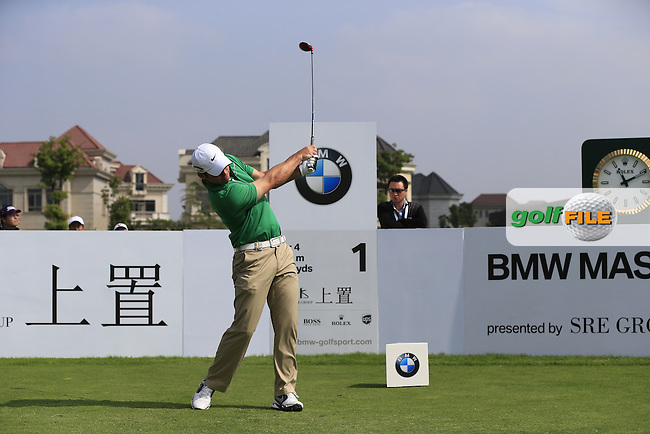 Paul Casey (ENG) tees off the 1st tee to start his match during Saturday's Round 3 of the 2013 BMW Masters presented by SRE Group held at Lake Malaren Golf Club, Shanghai, China. 26th October 2013.<br /> Picture: Eoin Clarke/www.golffile.ie