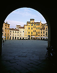 Lucca, Tuscany, Italy<br /> An archway frames Piazza Anfiteatro in early morning light in the town of Lucca