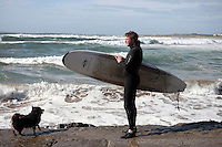 David Neville from NEV sail water sports checks out the surf at Dog Heaven Beach Co Clare, Ireland. Picture James Horan