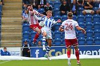 Danny Newton of Stevenage rises with Frankie Kent of Colchester United during Colchester United vs Stevenage, Sky Bet EFL League 2 Football at the Weston Homes Community Stadium on 12th August 2017