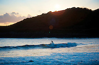 2015 01 16 Surfers during sunset in Langland, UK
