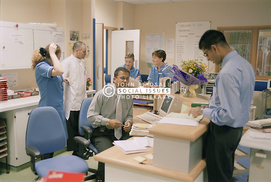 Medical staff at workstation on ENT ward in hospital,