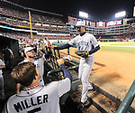 Hisashi Iwakuma (Mariners),<br /> JULY 4, 2013 - MLB :<br /> Hisashi Iwakuma of the Seattle Mariners high-fives his teammate in the dugout during the Major League Baseball game against the Texas Rangers at Rangers Ballpark in Arlington in Arlington, Texas, United States. (Photo by AFLO)