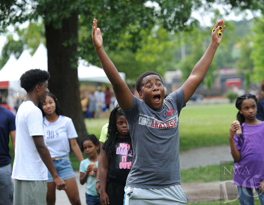 NWA Democrat-Gazette/ANDY SHUPE<br /> Collin Tims, 13, of Fayetteville reacts Saturday, June 17, 2017, while throwing a ball at a University of Arkansas Police Department dunk tank during the Juneteenth celebration in The Gardens on the university campus in Fayetteville. Juneteenth marks the anniversary of the emancipation of slaves in the United States.