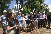 NWA Democrat-Gazette/FLIP PUTTHOFF <br /> NEW TRAIL TO HIKE, BIKE<br /> Arkansas State Parks officials and guests gather Friday June 7 2019 to dedicate a new 17.36-mile trail at Hobbs State Park-Conservation Area east of Rogers. The trail is open now open for hiking and mountain biking, with the trailhead located at the visitor center. Dedication festivities continue today at the park, with a ceremonial log cutting in lieu of a ribbon cutting at 9 a.m. Guided rides on the new trail start at 10 a.m. Mountain bikes will be available to use free of charge. The trail is the first of several Monument Trails planned for select Arkansas State Parks. Monument Trails are at least 10 miles long and have archetectural features such as campsites for backpacking and bikepacking. Other Monument Trails are planned at Devil's Den State Park, Mt. Nebo State Park and Pinnacle Mountain State Park. Suzanne Grobmyer (left), executive director of the Arkansas Parks and Recreation Foundation, and Grady Spann (center), Arkansas State Parks director (center) attend the dedication, which featured a bicycle tube cutting instead of a ribbon cuttning. Rogue Trails built the Monument Trail.