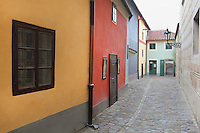 Golden Lane, within the northern bailey area of Prague Castle, which includes the home of Franz Kafka, 1883-1924, Czech writer and philosopher (not shown here), Prague, Czech Republic. The Golden Lane contained modest dwellings, which are now the last remains of the small-scale architecture of Prague Castle. They were inhabited by the castle servants, perhaps goldsmiths (hence the name) and the castle marksmen. The tiny houses were occupied until World War II, and have been preserved since then. The historic centre of Prague was declared a UNESCO World Heritage Site in 1992. Picture by Manuel Cohen
