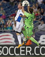 New England Revolution goalkeeper Bobby Shuttleworth (34) grabs a long pass to San Jose Earthquakes forward Ellis McLoughlin (25). In a Major League Soccer (MLS) match, the San Jose Earthquakes defeated the New England Revolution, 2-1, at Gillette Stadium on October 8, 2011.