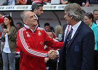 ( L-R ) Francesco Guidolin, Manager of Swansea City greets Manuel Pellegrini, Manager of Manchester City during the Swansea City FC v Manchester City Premier League game at the Liberty Stadium, Swansea, Wales, UK, Sunday 15 May 2016