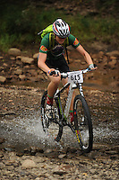 NWA Democrat-Gazette/ANDY SHUPE<br /> Glendon Van Sandt of Siloam Springs rides across Lee Creek Saturday, Sept. 19, 2015, during the Northwest Arkansas Mountain Bike Championships at Devil's Den State park.
