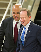 "United States Senators Cory Booker (Democrat of New Jersey) and Pat Toomey (Republican of Pennsylvania) on the escalator to go into the Senate Subway after the vote on the repeal of the Affordable Care Act (ACA) also known as ""Obamacare"" in the US Capitol in Washington, DC on Wednesday, July 26, 2017.  The Senate voted 55-45 to reject legislation undoing major portions of President Barack Obama's signature healthcare law without a plan to replace it.<br /> Credit: Ron Sachs / CNP"
