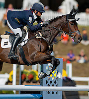 Anthony Patch, with rider Laine Ashker (USA), competes during the Stadium Jumping test during the Fair Hill International at Fair Hill Natural Resources Area in Fair Hill, Maryland on October 21, 2012.