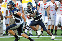 27 November 2010:  FIU running back Darriet Perry (28) carries the ball in the third quarter as the FIU Golden Panthers defeated the Arkansas State Red Wolves, 31-24, at FIU Stadium in Miami, Florida.