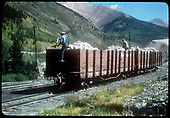 2 gondolas filled with limestone on siding. Men working on rock.<br /> D&amp;RGW  Monarch, CO