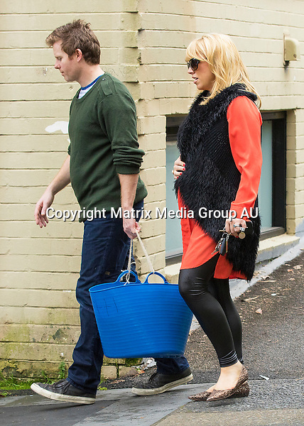 14 JULY 2015 SYDNEY AUSTRALIA<br /> <br /> EXCLUSIVE PICTURES<br /> <br /> Monique Wright pictured with her husband Tim Scanlan with her two kids Ettienne and Pascale after swimming lessons. Monique is glowing with her third child on its way.
