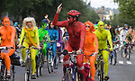Brightly painted nude bicycle riders delight the crowd during the 21st  Annual Fremont Summer Solstice Parade in Seattle on June 20, 2009.  The parade was held Saturday, bringing out painted and naked bicyclists, bands, belly dancers and floats. (Jim Bryant Photo © 2009)