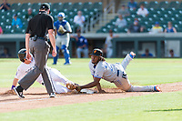 Surprise Saguaros third baseman Vladimir Guerrero Jr. (27), of the Toronto Blue Jays organization, applies the tag to Tyler Nevin (2) in front of third base umpire Bryan Fields during an Arizona Fall League game against the Salt River Rafters at Salt River Fields at Talking Stick on October 23, 2018 in Scottsdale, Arizona. Salt River defeated Surprise 7-5 . (Zachary Lucy/Four Seam Images)