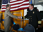 Carson City Mayor Bob Crowell congratulates Deputy Chief Chris Vaughn during a badge-pinning ceremony at Carson Fire Department in Carson City, Nev., on Monday, Oct. 16, 2017. <br /> Photo by Cathleen Allison/Nevada Momentum