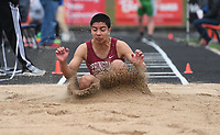 NWA Democrat-Gazette/J.T. WAMPLER Springdale's Christian Ramirez competes in the long jump Thursday April 26, 2018 at the 7A-West Conference track meet at War Eagle Stadium at Rogers Heritage High School.