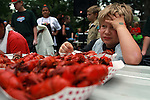 I guess eating crawfish is not for everyone. Jacob Balin,9, of Wilsonville just couldn't eat no more crawfish during the Tualatin Crawfish kids eating contest on Saturday, August 8, 2009. Balin ate 1. The look on his face with his hand gripping his forehead says it all. Oh well, there's always next year.