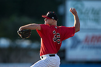Kannapolis Intimidators relief pitcher Matt Cooper (32) delivers a pitch to the plate against the Greensboro Grasshoppers at CMC-Northeast Stadium on August 2, 2015 in Kannapolis, North Carolina.  The Intimidators defeated the Grasshoppers 4-2.  (Brian Westerholt/Four Seam Images)
