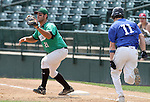 SIOUX FALLS, SD - AUGUST 18:  Jason Nyhus #21 from the Renner Monarchs squeezes the ball at first as Brett Fischer #11 from the Sioux Falls Brewers is out on the play during the xxxx inning Sunday afternoon during the Class A Amateur Baseball Tournament at the Sioux Falls Stadium. (Photo by Dave Eggen/Inertia)