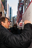 U.S. men's head coach Jurgen Klinsmann signs an autograph board during the centennial celebration of U. S. Soccer at Times Square in New York, NY, on April 04, 2013.