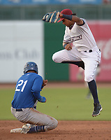 NWA Democrat-Gazette/ANDY SHUPE<br /> Northwest Arkansas Naturals shortstop Erick Mejia leaps to field the high throw from the outfield as Tulsa Drillers left fielder Jacob Scavuzzo slides in safely at second Wednesday, July 11, 2018, during the fourth inning at Arvest Ballpark in Springdale. Visit nwadg.com/photos to see more photographs from the game.
