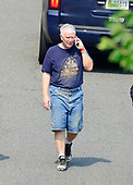 United States Representative Mo Brooks (Republican of Alabama), in dirty blue shirt, speaks on the phone as he walks to his car after a gunman opened fire on members of Congress who were practicing for the annual Congressional baseball game in Alexandria, Virginia on Wednesday, June 14, 2017.<br /> Credit: Ron Sachs / CNP<br /> (RESTRICTION: NO New York or New Jersey Newspapers or newspapers within a 75 mile radius of New York City)