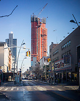 High-rise construction is seen on Fulton Street in Downtown Brooklyn in New York on Saturday, January 26, 2013.  As more high-rise condominiums are built in the area the demographics are changing and chain stores are renting space in Downtown Brooklyn. The chains can pay higher rents and are forcing some of the local stores to close.  (© Richard B. Levine)