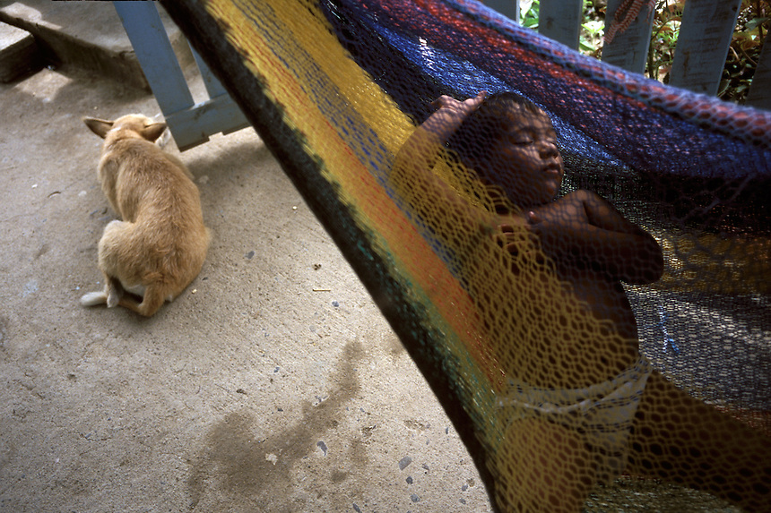 A child naps in a hammock in Limón de la Cerca, Honduras.