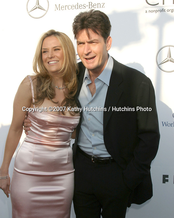Charlie Sheen & Date.6th Annual Chrysalis Butterfly Ball.Private Home of Susan Harris & Hayward Kaiser.Brentwood, CA.June 2, 2007.©2007 Kathy Hutchins / Hutchins Photo....