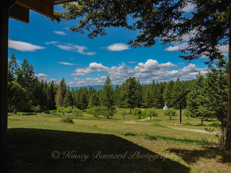 White billowy clouds float in the bright blue Montana sky over the Kootenai National Forest