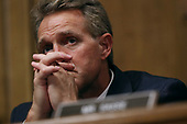 WASHINGTON, DC - SEPTEMBER 27:  Senate Judiciary Committee member Sen. Jeff Flake (R-AZ) listens to testimony from Christine Blasey Ford in the Dirksen Senate Office Building on Capitol Hill September 27, 2018 in Washington, DC. A professor at Palo Alto University and a research psychologist at the Stanford University School of Medicine, Ford has accused Supreme Court nominee Judge Brett Kavanaugh of sexually assaulting her during a party in 1982 when they were high school students in suburban Maryland.  (Photo by Win McNamee/Getty Images)