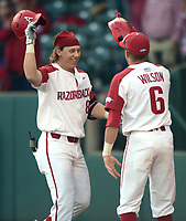 NWA Democrat-Gazette/ANDY SHUPE<br />Arkansas right fielder Eric Cole (left) is given the Hog hat by Hunter Wilson after hitting a 3-run home run against Kent State Friday, March 9, 2018, during the fourth inning at Baum Stadium in Fayetteville. Visit nwadg.com/photos to see more photographs from the game.