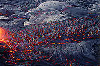 Pahoehoe lava river solidifying into its characteristic form