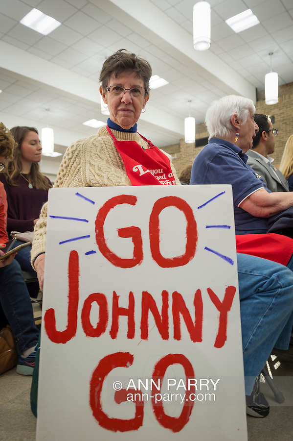 Hempstead, New York, USA. April 4, 2016. MAUREEN O'BRIEN, from Bethpage, holds a 'GO Johnny GO' sign she brought to Town Hall hosted by JOHN KASICH, Republican presidential candidate and governor of Ohio, at Hofstra University David Mack Student Center in Long Island. O'Brien is a registered Republican and supports Kasich. The New York primary is April 19, and Kasich is the first of the three GOP presidential candidates to campaign in Nassau and Suffolk Counties, and is in third place in number of delegates won.