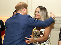 Prince Harry Duke of Cambridge speaks to Rita Ora during a reception for the concert hosted by his charity Sentebale at Hampton Court Palace, in London. The concert will raise funds and awareness for Sentebale, the charity founded by Prince Harry and Lesotho's Prince Seeiso in 2006, to support children and young people affected by HIV and AIDS in Lesotho, Botswana and Malawi. Photo Credit: ALPR/AdMedia
