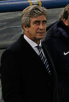 Manchester City's headcoach Marco Pellegrini  during the Champions League Group E soccer match between As Roma and Manchester City  at the Olympic Stadium in Rome December 10 , 2014.