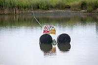 Warning signs in irrigation reservoir - Lincolnshire, June