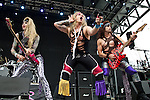 Travis Haley, Ralph Saenz, and Russ Parrish of Steel Panther perform during the 2013 Rock On The Range festival at Columbus Crew Stadium in Columbus, Ohio.