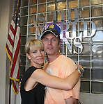 Kelley Menighan Hensley & Jon Hensley by ATWT logo - As The World Turns' shoots its last show on June 23, 2010 at the studios in Brooklyn, New York. (Photo by Sue Coflin/Max Photos)
