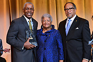 Washington,  DC- September 14, 2018: Norman Jenkins Norman Jenkins, Dorothy Leavell, Benjamin Chavis Jr receives a leadership award from Dorothy Leavell and Benjamin Chavis, Jr. during 2018 National Newspapers Publishers Association awards banquet held at the Marriott Marquis in Washington, D.C. September 14, 2018.  (Photo by Don Baxter/Media Images International)